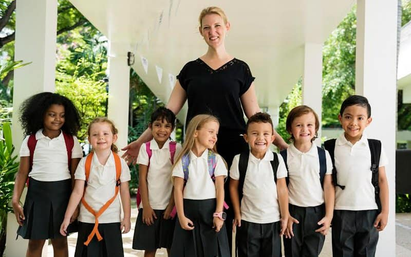 international school teacher with kids